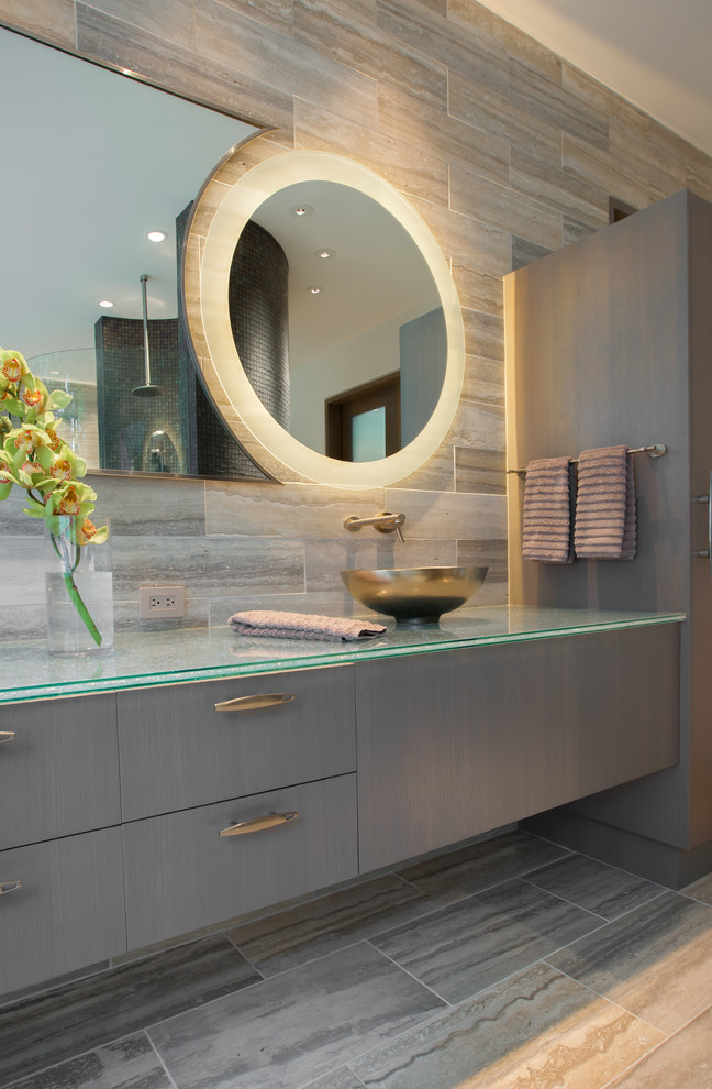 Trendy travertine tile bathroom photo in Dallas with a vessel sink, flat-panel cabinets, gray cabinets and glass countertops