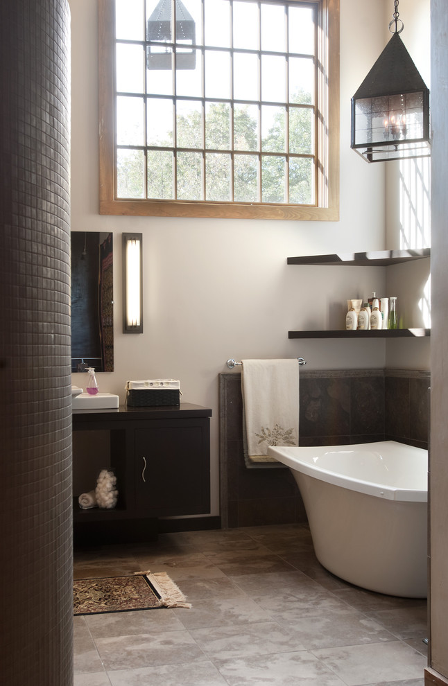 Inspiration for a mid-sized timeless 3/4 mosaic tile and gray tile porcelain tile freestanding bathtub remodel in Philadelphia with flat-panel cabinets, dark wood cabinets, a two-piece toilet, gray walls, a vessel sink and quartz countertops