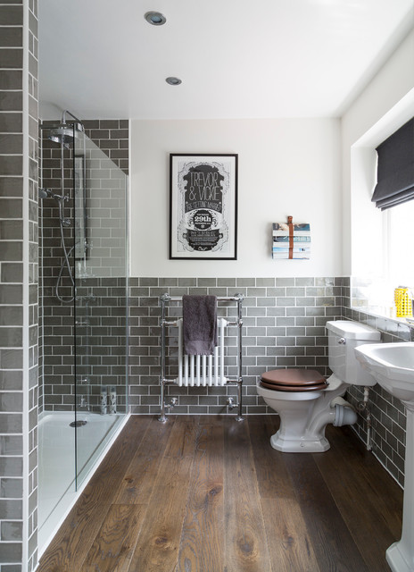 Inspiration for a traditional bathroom in Buckinghamshire with a pedestal sink, an alcove shower, a two-piece toilet, grey tiles, metro tiles, white walls, dark hardwood flooring and brown floors.