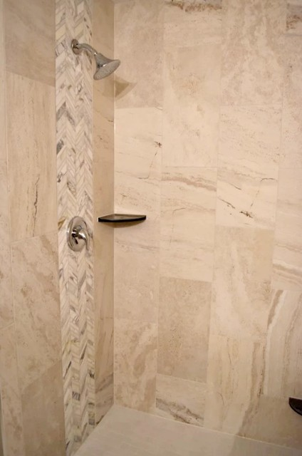 Example of a mid-sized transitional limestone tile alcove shower design in Other with an undermount sink, granite countertops and a hinged shower door