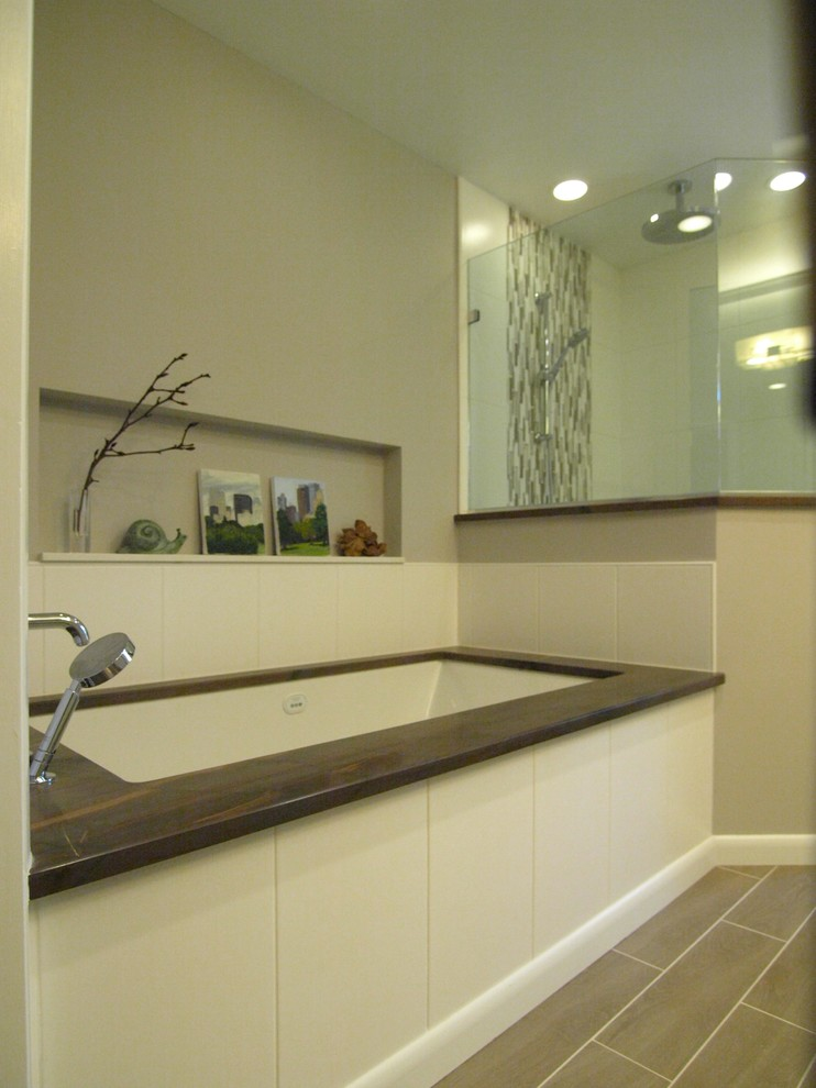 Mid-sized transitional master beige tile and ceramic tile laminate floor and gray floor bathroom photo in Newark with recessed-panel cabinets, white cabinets, gray walls, a hinged shower door, a one-piece toilet, an undermount sink and granite countertops