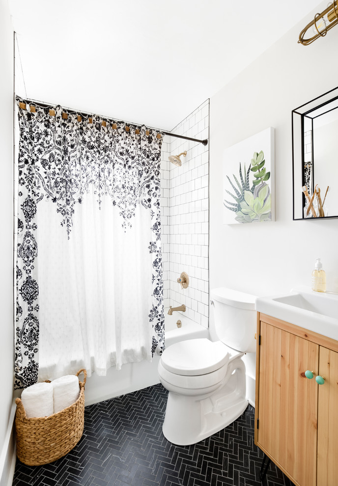 Inspiration for a small coastal white tile and ceramic tile marble floor and black floor bathroom remodel in Charlotte with light wood cabinets, a two-piece toilet, flat-panel cabinets, white walls and a console sink