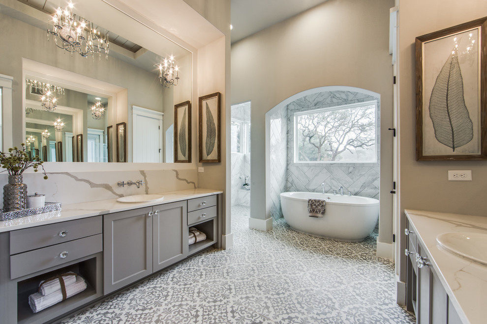Inspiration for a large farmhouse master white tile, gray tile and ceramic tile cement tile floor and white floor bathroom remodel in Austin with shaker cabinets, gray cabinets, gray walls, quartz countertops and a drop-in sink