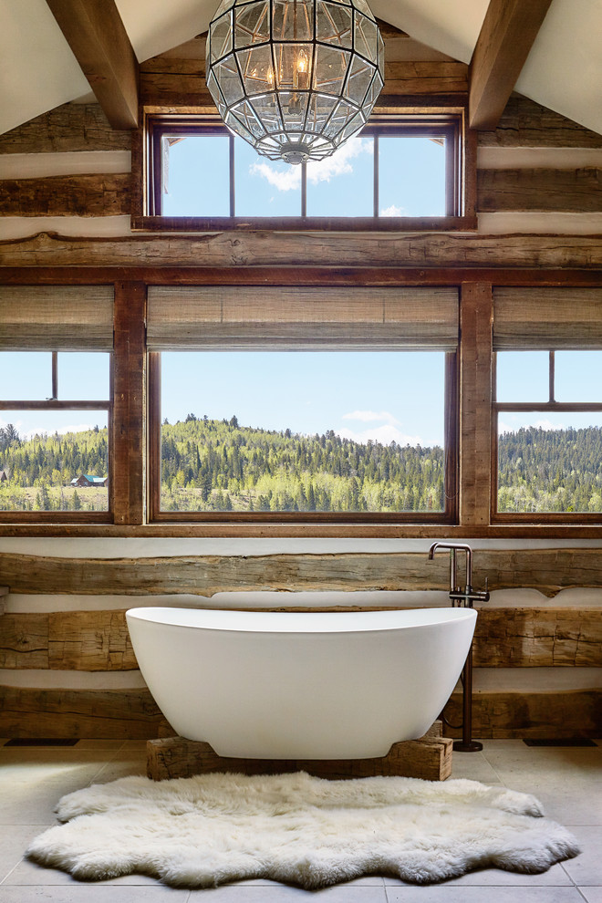 Example of a mountain style master freestanding bathtub design in Other