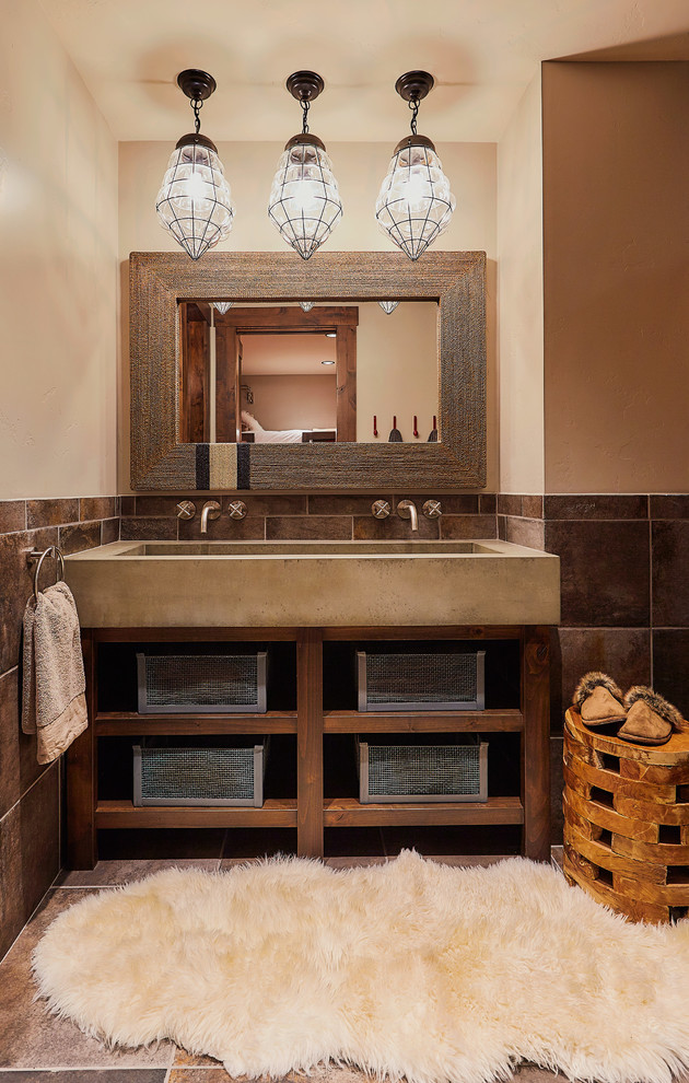 Bathroom - rustic master brown tile bathroom idea in Other with open cabinets, dark wood cabinets, beige walls and a trough sink