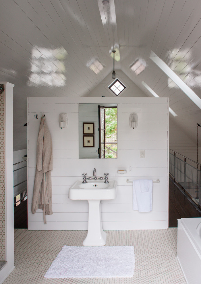 Inspiration for a rustic white tile bathroom remodel in Montreal with a pedestal sink