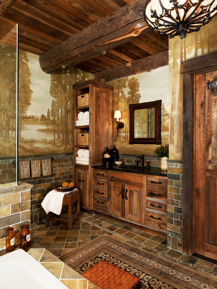 Example of a mid-sized mountain style master brown tile ceramic tile corner shower design in Detroit with an undermount tub, medium tone wood cabinets, shaker cabinets, multicolored walls and solid surface countertops