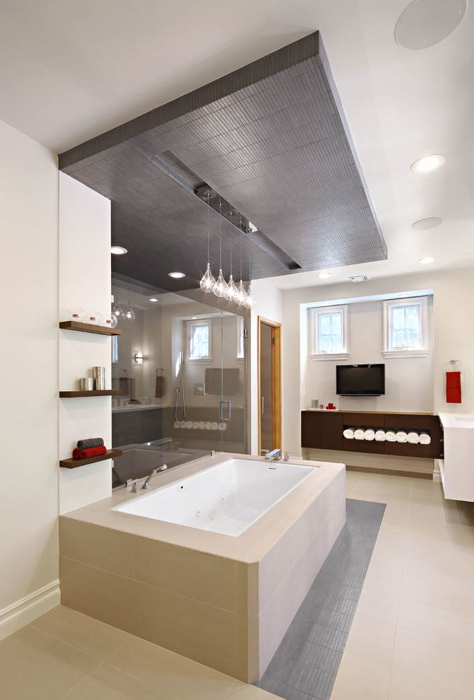 Inspiration for a mid-sized contemporary master beige tile porcelain tile alcove shower remodel in Los Angeles with flat-panel cabinets, dark wood cabinets, an undermount tub, white walls, an integrated sink and quartz countertops