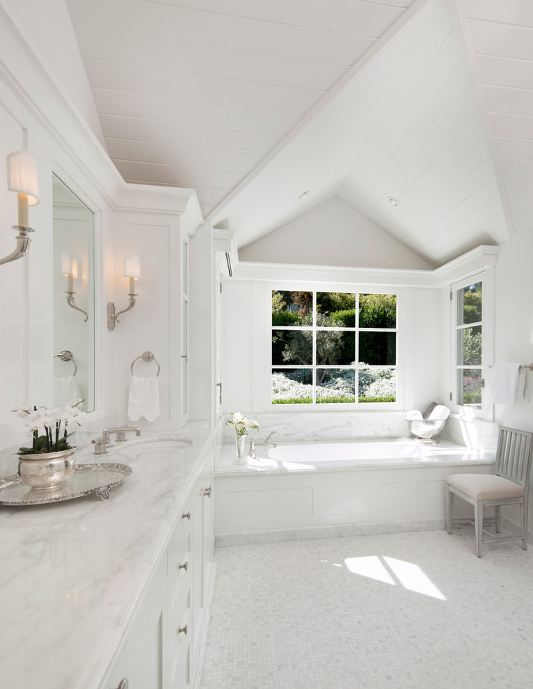 Bathroom - traditional white tile mosaic tile floor bathroom idea in Santa Barbara with an undermount sink, white cabinets, marble countertops, an undermount tub, white walls, shaker cabinets and white countertops