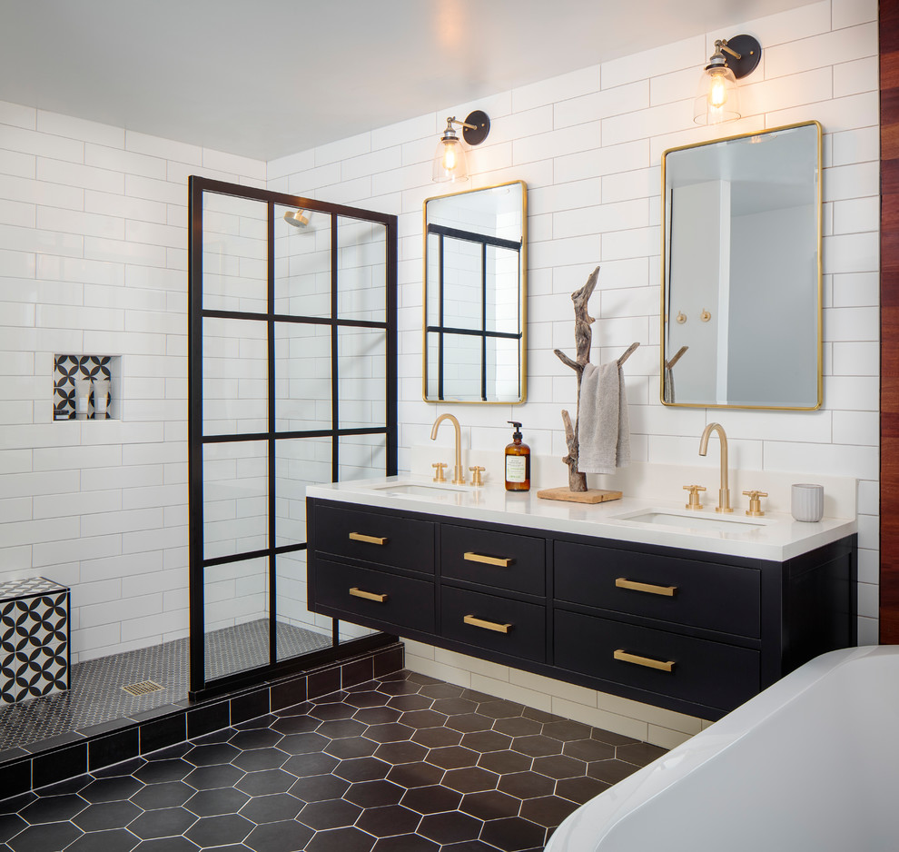 Mid-sized trendy master white tile and porcelain tile cement tile floor and black floor bathroom photo in San Diego with flat-panel cabinets, black cabinets, a one-piece toilet, white walls, an undermount sink, quartz countertops and white countertops