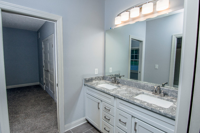 Bathroom - transitional gray tile, white tile and subway tile porcelain floor and gray floor bathroom idea in Columbus with shaker cabinets, white cabinets, green walls, an undermount sink and marble countertops