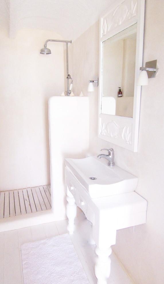 Bathroom - mediterranean bathroom idea in Palma de Mallorca with a console sink