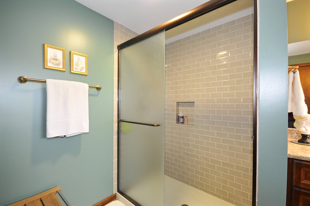 Inspiration for a mid-sized timeless 3/4 gray tile and ceramic tile ceramic tile alcove shower remodel in Indianapolis with an undermount sink, raised-panel cabinets, dark wood cabinets, quartz countertops, a one-piece toilet and blue walls