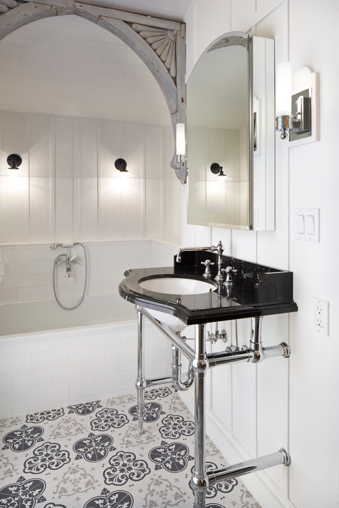 Mid-sized transitional 3/4 white tile and subway tile porcelain tile and multicolored floor bathroom photo in Other with white walls, a console sink and solid surface countertops