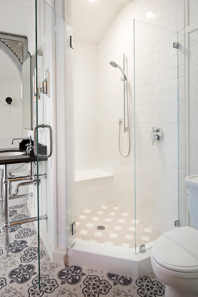 Example of a mid-sized transitional corner shower design in Other with white walls