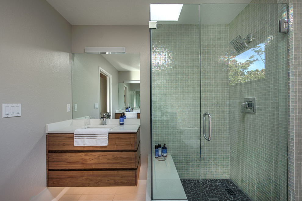 Mid-sized 1950s 3/4 gray tile and mosaic tile ceramic floor and beige floor corner shower photo in Other with flat-panel cabinets, dark wood cabinets, beige walls, an undermount sink, quartz countertops and a hinged shower door