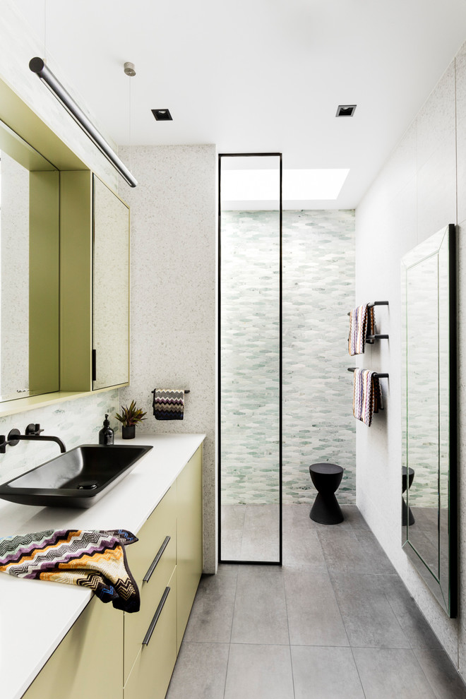 Bathroom - contemporary green tile and mosaic tile gray floor bathroom idea in Melbourne with flat-panel cabinets, green cabinets, white walls, a vessel sink and white countertops