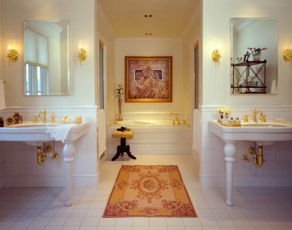 Elegant bathroom photo in New York with a console sink