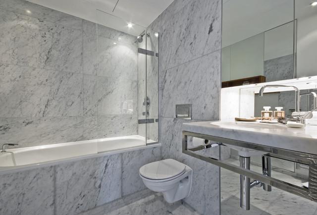 Carrara marble tile white bathroom contemporary for Contemporary white bathroom tiles