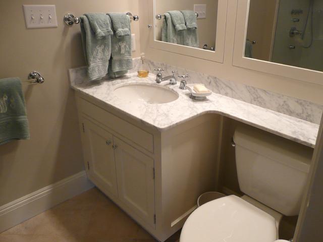 carrara marble vanity top and backsplash traditional bathroom