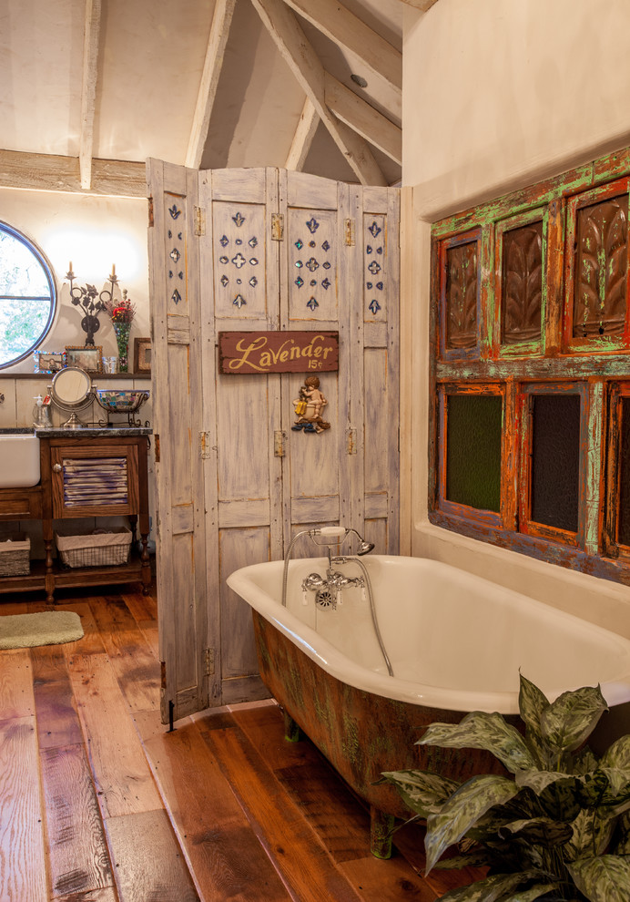 Freestanding bathtub - shabby-chic style freestanding bathtub idea in Dallas with distressed cabinets and louvered cabinets