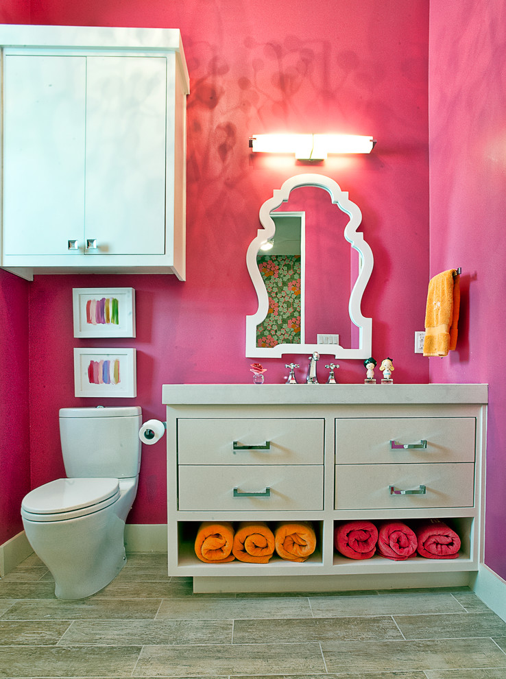 Trendy kids' bathroom photo in Austin with flat-panel cabinets, white cabinets and a two-piece toilet