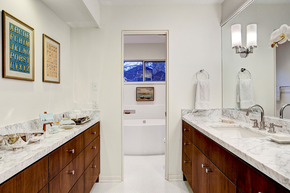 Example of a mid-sized mid-century modern master white tile and ceramic tile mosaic tile floor bathroom design in Houston with flat-panel cabinets, dark wood cabinets, a one-piece toilet, white walls, an undermount sink and marble countertops