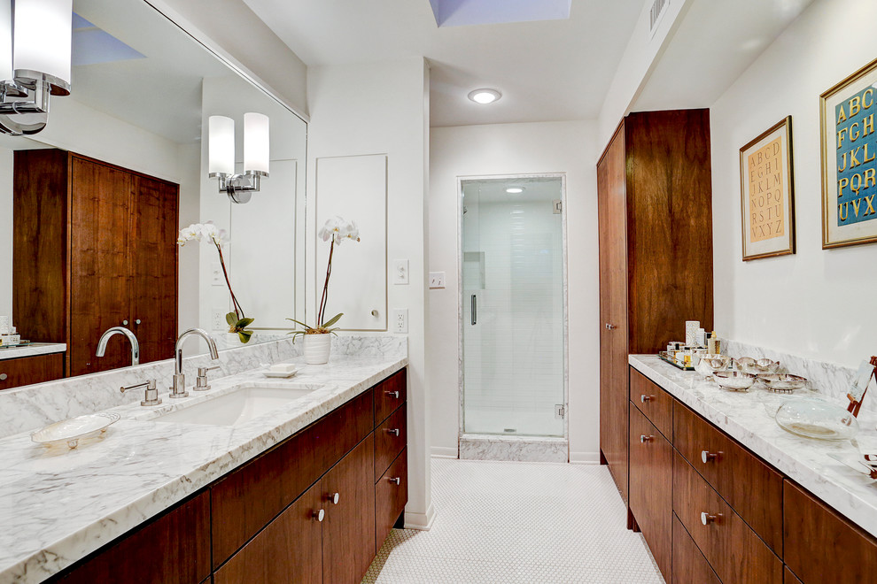 Bathroom - mid-sized mid-century modern master white tile and ceramic tile mosaic tile floor and white floor bathroom idea in Houston with flat-panel cabinets, dark wood cabinets, a one-piece toilet, white walls, an undermount sink, marble countertops and a hinged shower door