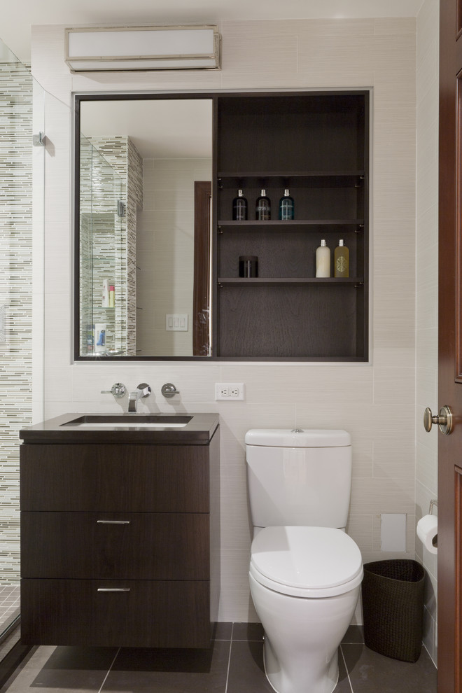Example of a trendy matchstick tile and beige tile bathroom design in New York with flat-panel cabinets and dark wood cabinets