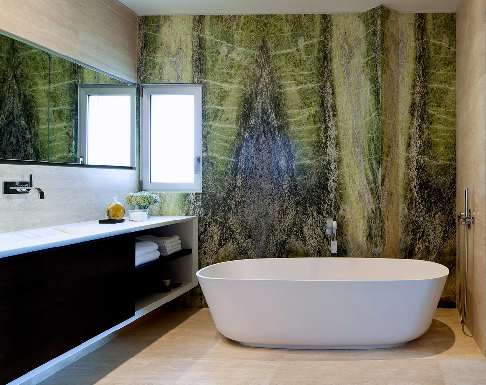 Example of a trendy marble tile freestanding bathtub design in Tel Aviv with green walls