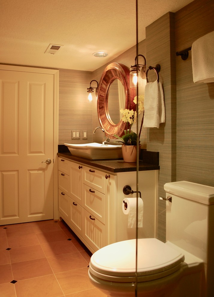 Inspiration for a small transitional orange tile and ceramic tile ceramic tile and orange floor alcove shower remodel in Portland with beaded inset cabinets, white cabinets, a one-piece toilet, gray walls, a vessel sink, granite countertops, a hinged shower door and black countertops