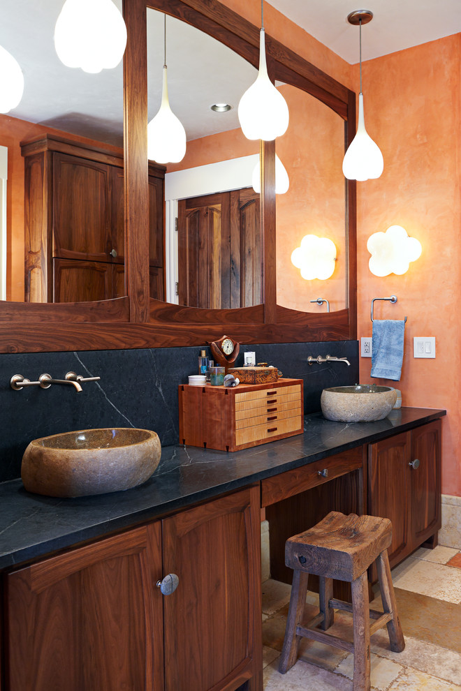 Inspiration for a large rustic master alcove shower remodel in Other with a vessel sink, soapstone countertops, orange walls, recessed-panel cabinets, a hinged shower door and blue countertops
