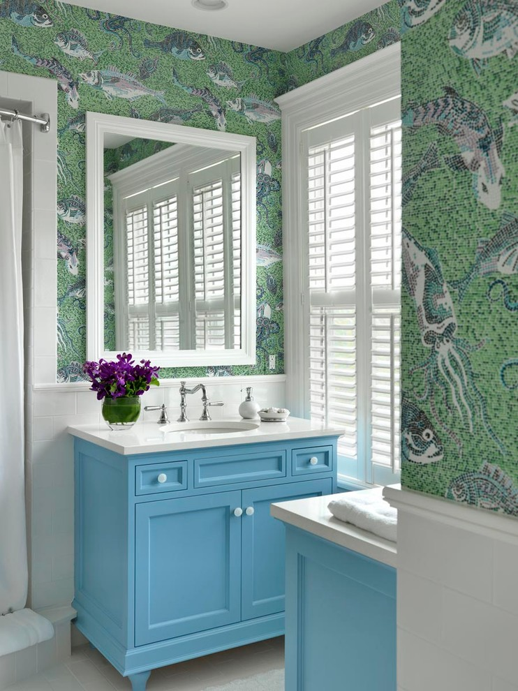 Mid-sized beach style 3/4 white tile and mosaic tile porcelain tile alcove shower photo in Boston with an undermount sink, recessed-panel cabinets, blue cabinets, quartz countertops, multicolored walls and white countertops