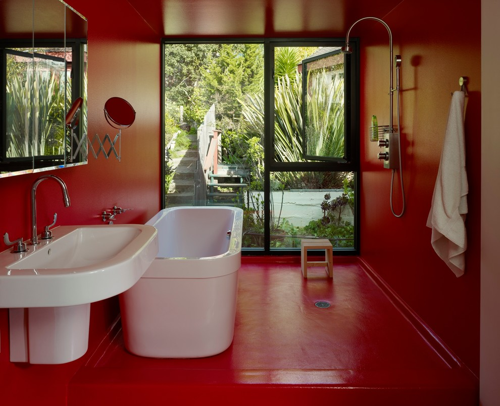 Mid-sized minimalist master red floor bathroom photo in San Francisco with a wall-mount sink, red walls and flat-panel cabinets