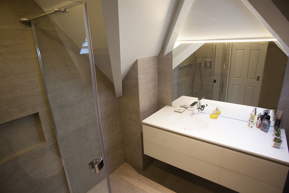 Walk-in shower - small contemporary master gray tile and porcelain tile porcelain floor walk-in shower idea in London with flat-panel cabinets, white cabinets, a one-piece toilet, gray walls, a console sink and engineered quartz countertops