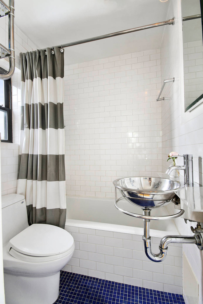 Inspiration for a small contemporary white tile and subway tile mosaic tile floor and blue floor bathroom remodel in New York with a wall-mount sink, a one-piece toilet, white walls and glass countertops