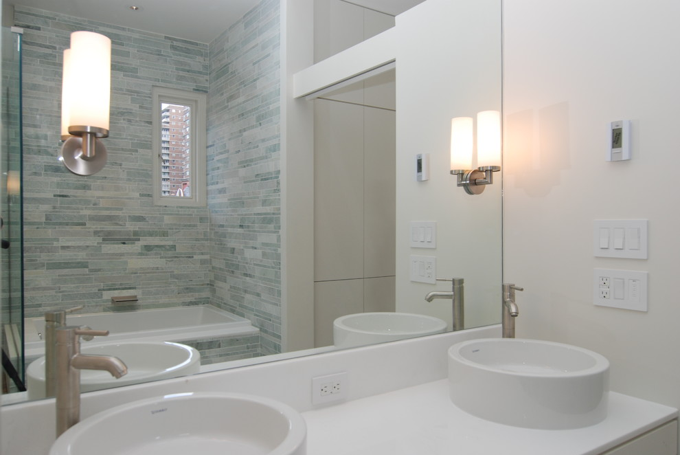 Example of a minimalist bathroom design in New York with a vessel sink