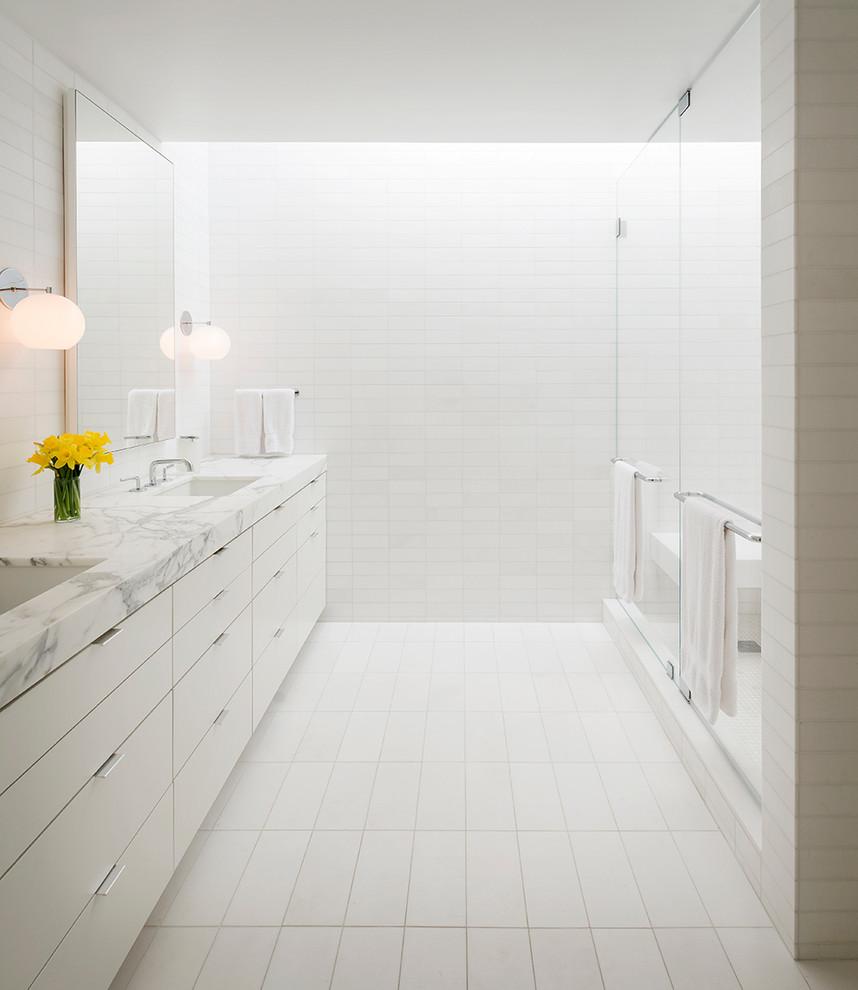 Bathroom - contemporary white tile bathroom idea in San Francisco with marble countertops
