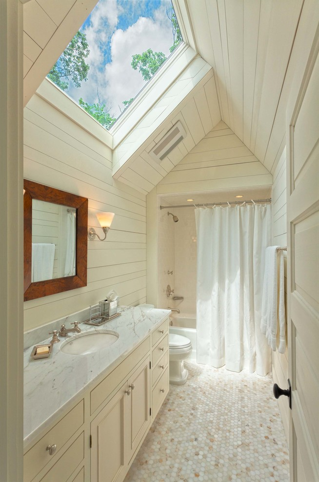 Mountain style bathroom photo in Other with marble countertops