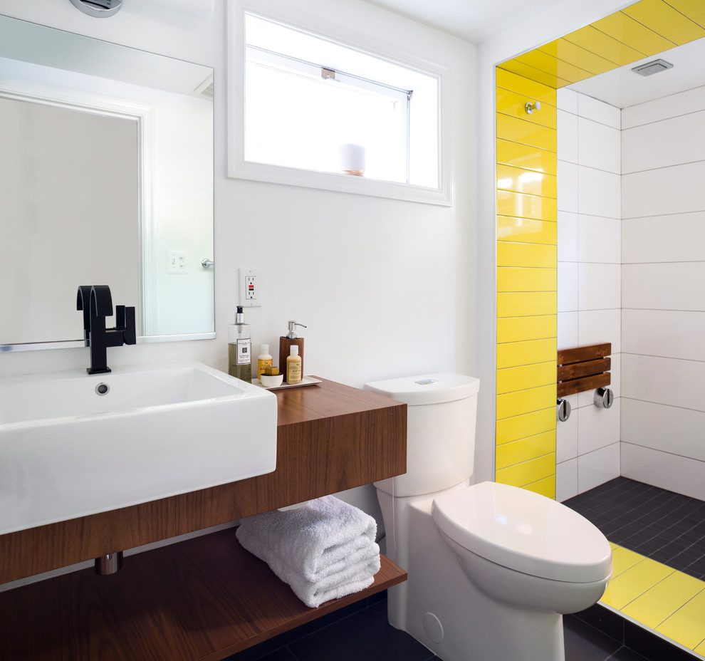 Example of a small trendy master black tile, white tile and yellow tile bathroom design in DC Metro with white walls, open cabinets, dark wood cabinets, a two-piece toilet, a vessel sink, wood countertops and brown countertops