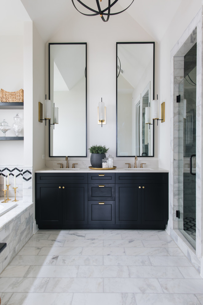 Design ideas for a farmhouse bathroom in Chicago with recessed-panel cabinets, black cabinets, a built-in bath, an alcove shower, white tiles, white walls, a submerged sink, white floors, a hinged door and white worktops.