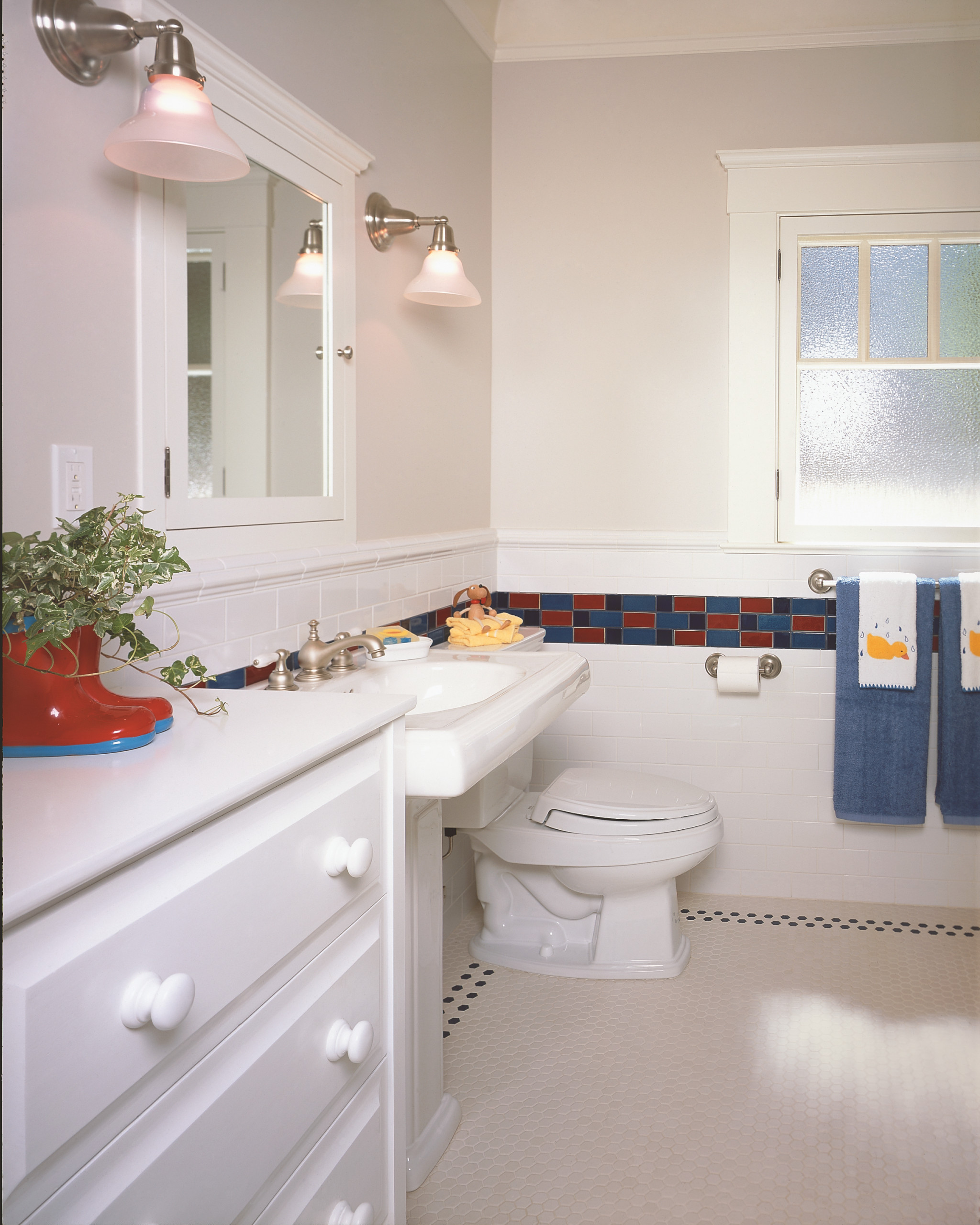 Children's bathroom with tile and built in cabinetry