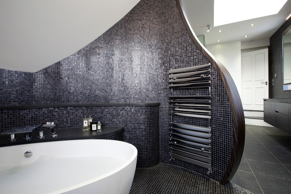 Mid-sized trendy 3/4 gray tile and mosaic tile ceramic tile bathroom photo in London with an undermount sink, flat-panel cabinets, dark wood cabinets, solid surface countertops, a one-piece toilet and white walls