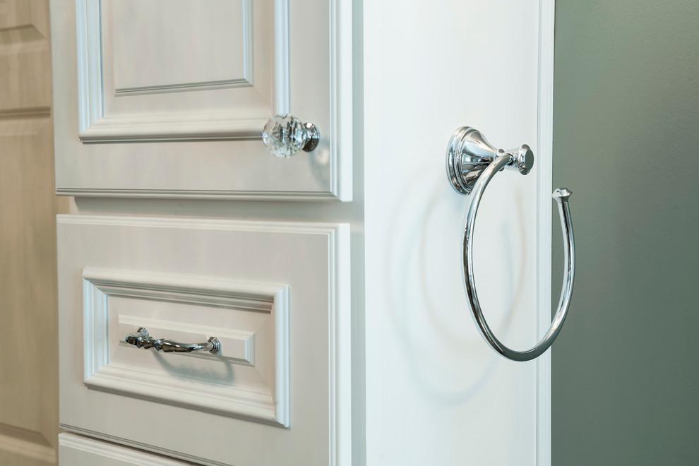 Chrome & crystal hardware on white raised panel cabinets ...