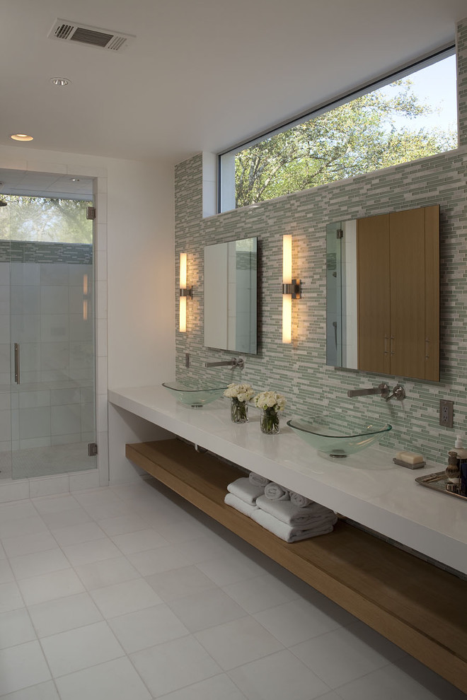 Example of a large trendy master green tile, white tile and glass tile ceramic tile alcove shower design in Austin with a vessel sink, white walls, open cabinets, medium tone wood cabinets and quartz countertops