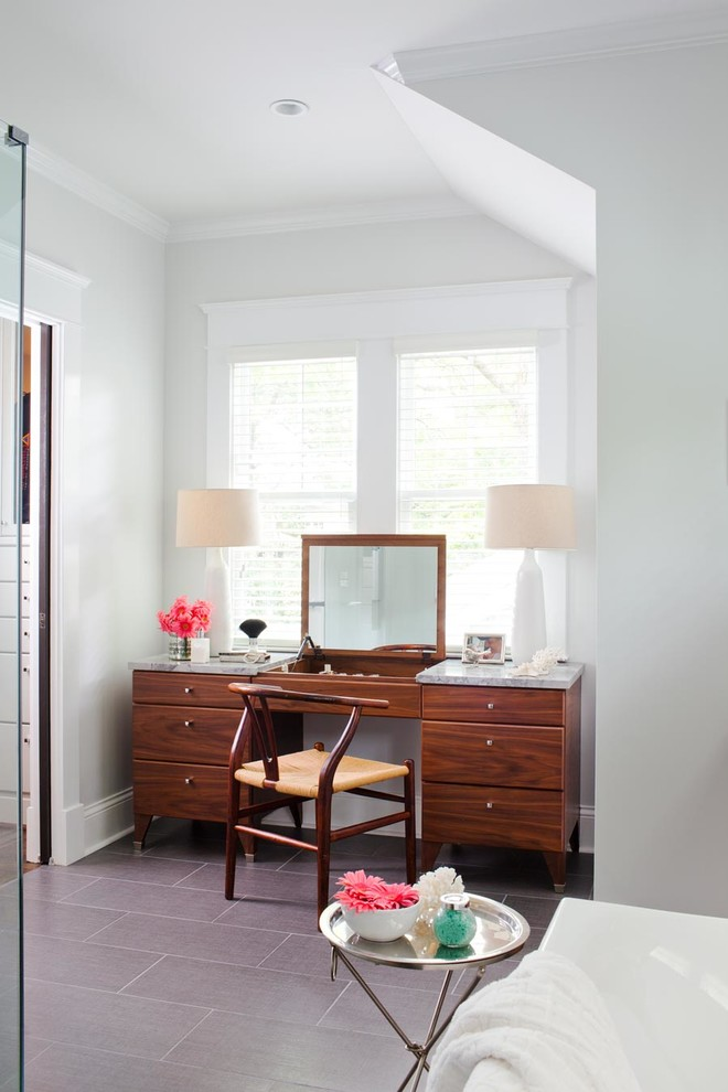Inspiration for a mid-sized contemporary master gray tile freestanding bathtub remodel in Atlanta with marble countertops, an undermount sink, medium tone wood cabinets, gray walls and flat-panel cabinets