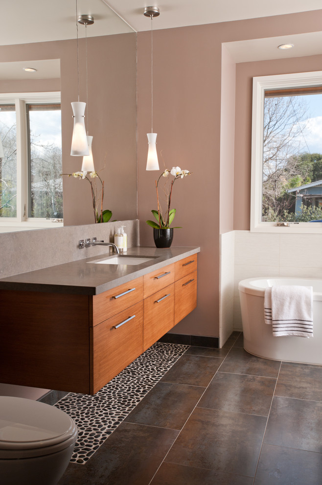 Inspiration for a contemporary freestanding bathtub remodel in San Francisco with flat-panel cabinets, medium tone wood cabinets and gray countertops