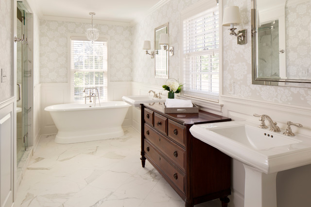 Elegant Freestanding Bathtub Photo In Milwaukee With A Pedestal Sink,  Raised Panel Cabinets,