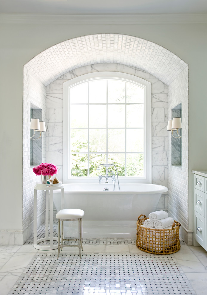 Example of a large classic master white tile marble floor freestanding bathtub design in Atlanta with recessed-panel cabinets, white cabinets and white walls