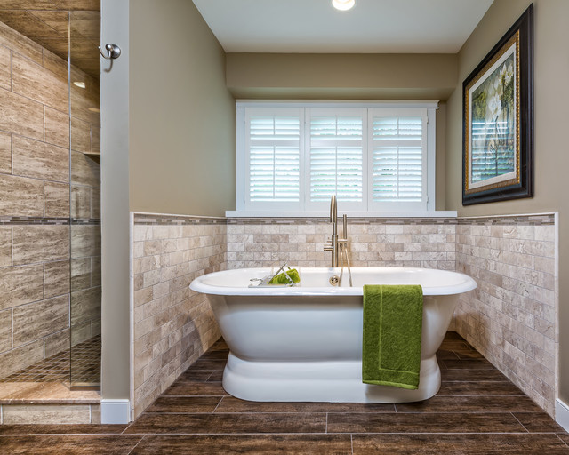 mid sized transitional master beige tile and travertine tile dark wood floor and brown floor - Bathroom Tiles Around Tub